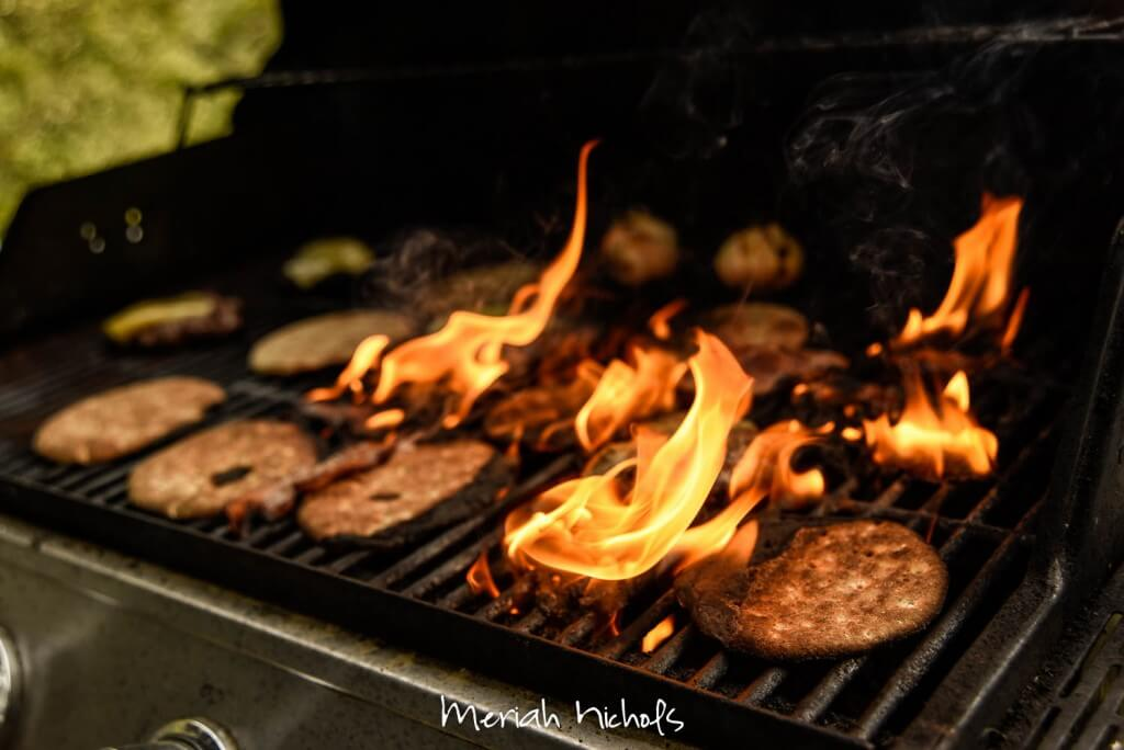 meat and bread on fire on a grill
