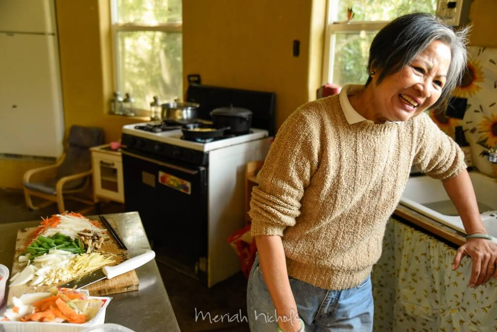 woman laughing in the kitchen