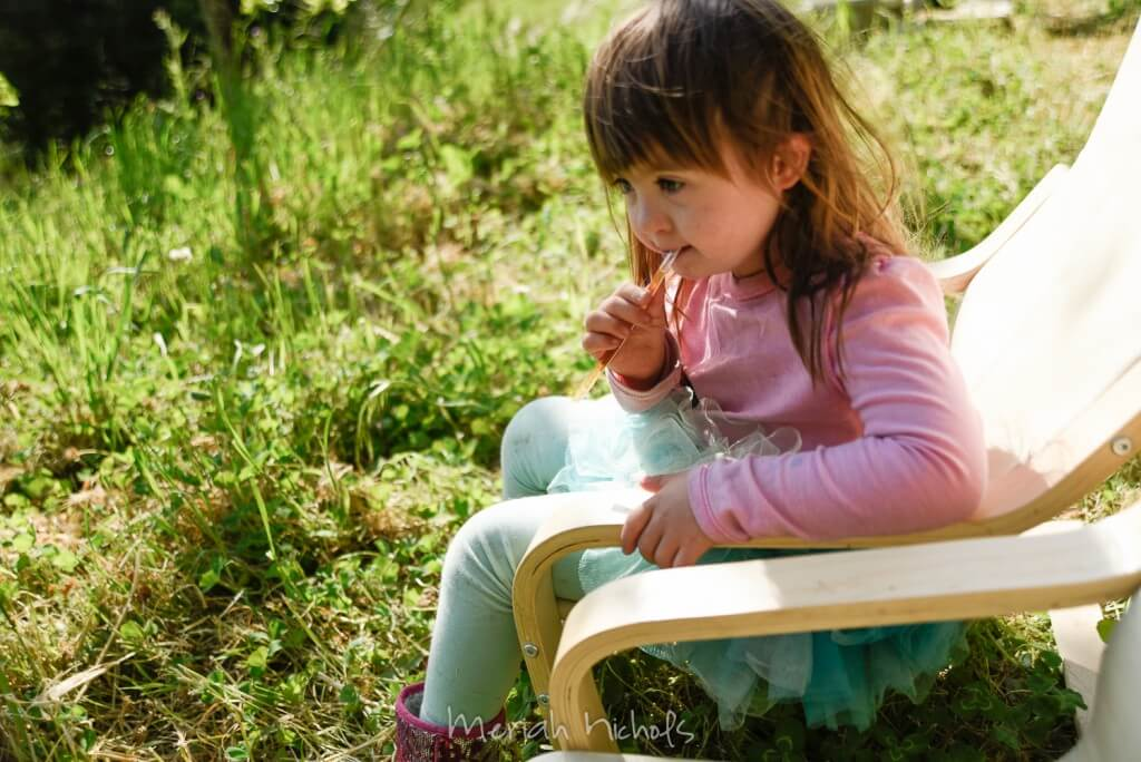 little girl with honey stick
