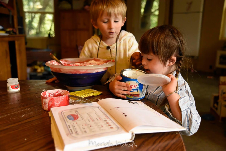 two children make playdough