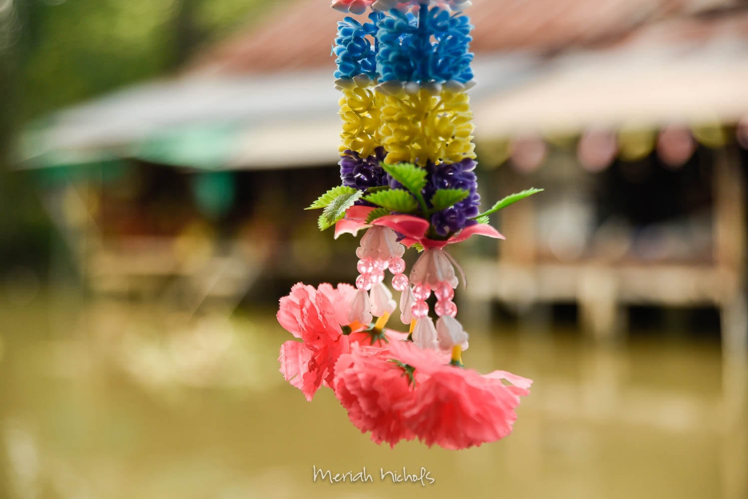 flowers from a shrine at amhawan floating market