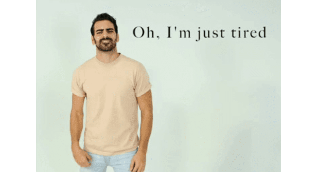 why nyle dimarco needs a wheelchair - image of a man with cream shirt and jeans, he has dark hair and is smiling, text reads,