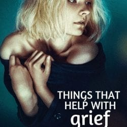 things that help with grief | image of a woman with light hair with hands clasped, looking down into the light