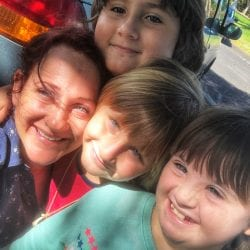 how to get services for your child with special needs: photo of meriah nichols and her 3 kids: a woman smiling into the camera with three young children, one girl and two boys, all smiling