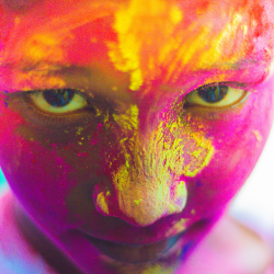 """Image of a person's face, covered in different colors of dust. the person is looking directly and intently ahead. text is at the top of the image, reading """"changing our understanding of what disability is"""""""