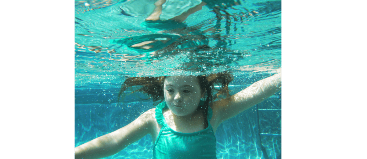 image of a girl with down syndrome swimming under water