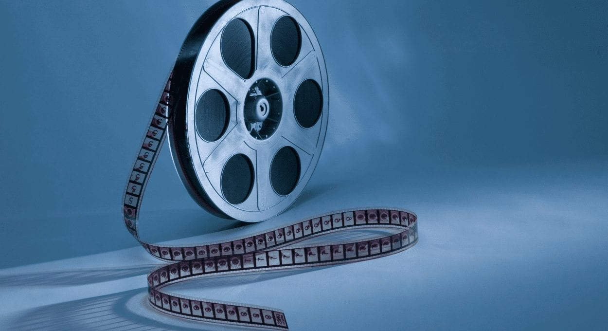best disability movies: image description: blue background with a film reel with film coming out of it, all in shades of blue