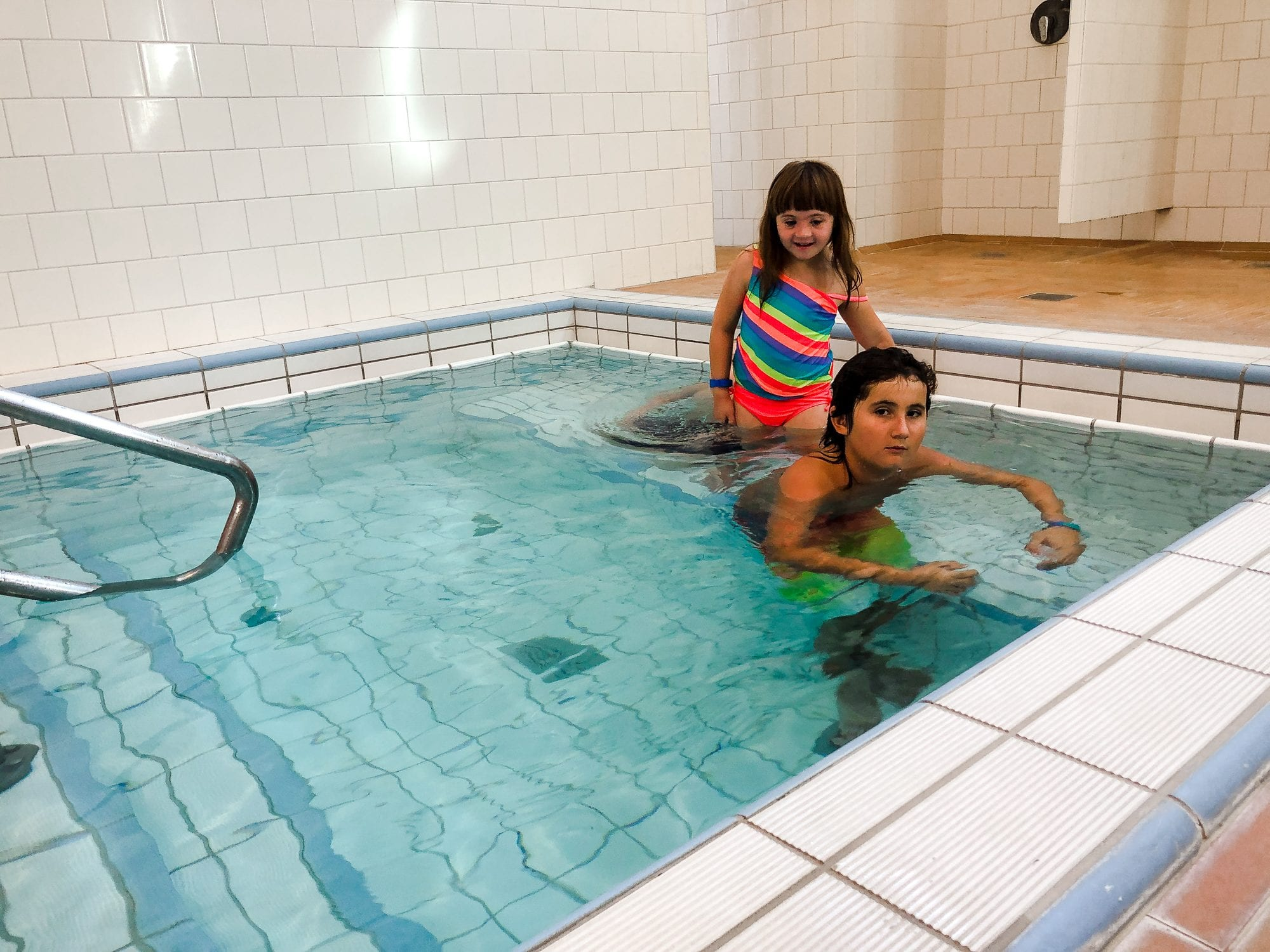 two children in the hot pool in the szechenyi baths