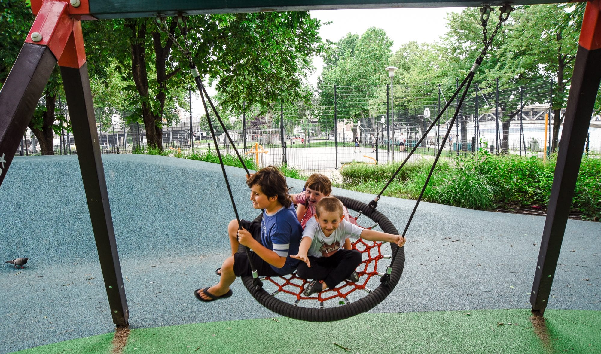 children on round swing