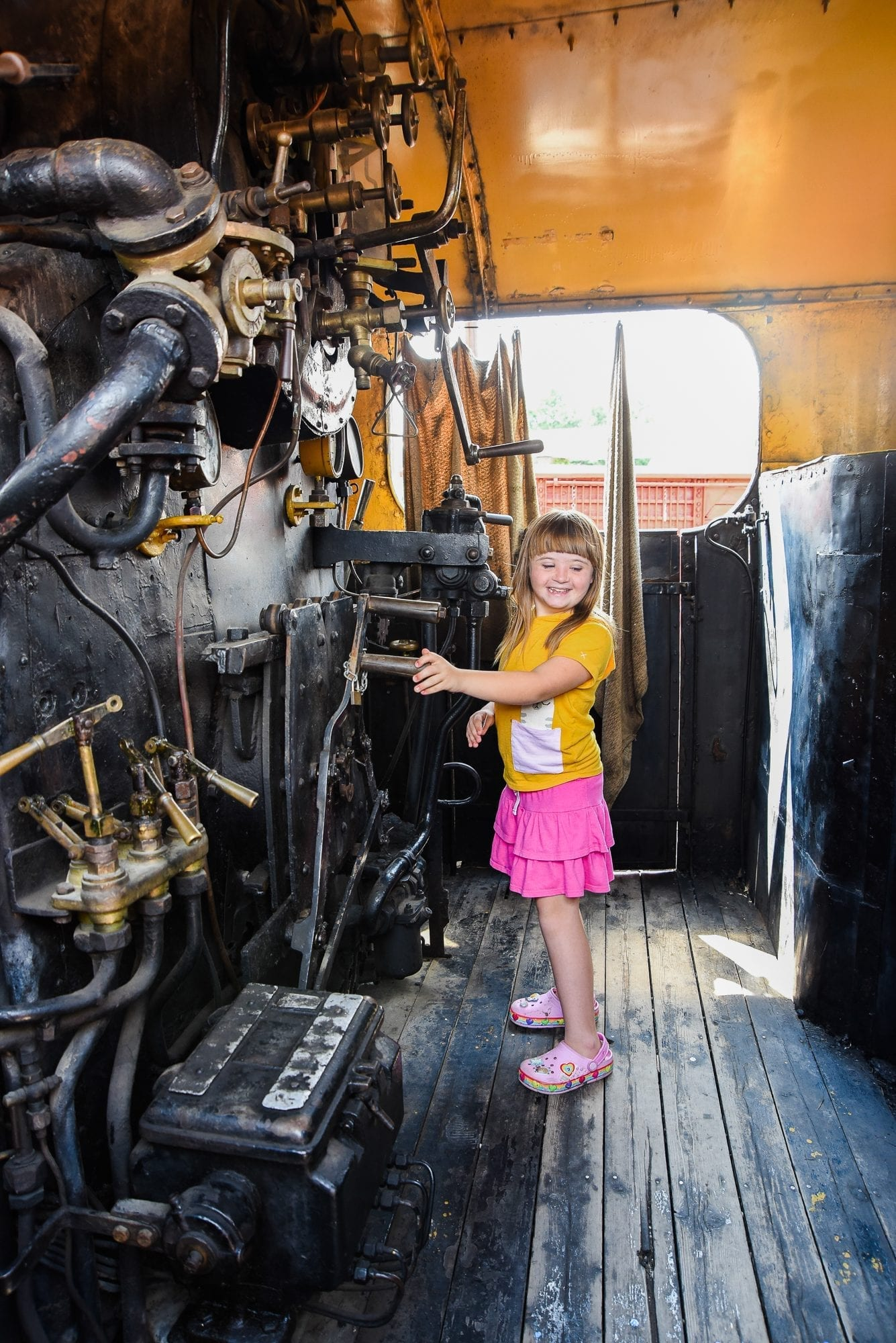 child in an old train