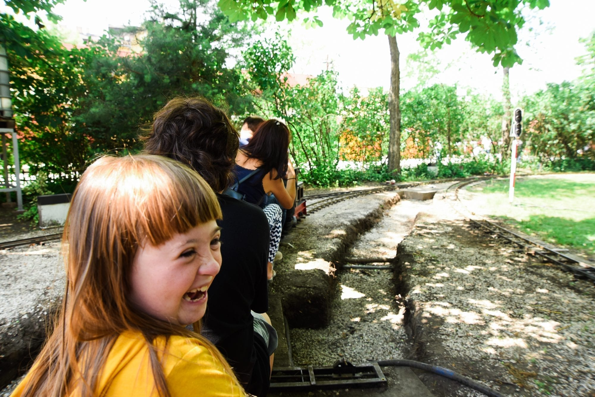 child smiling on a miniture train