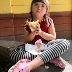 little girl eating gyro