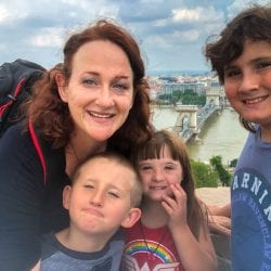 meriah nichols and kids by the castle in budapest overlooking chain bridge