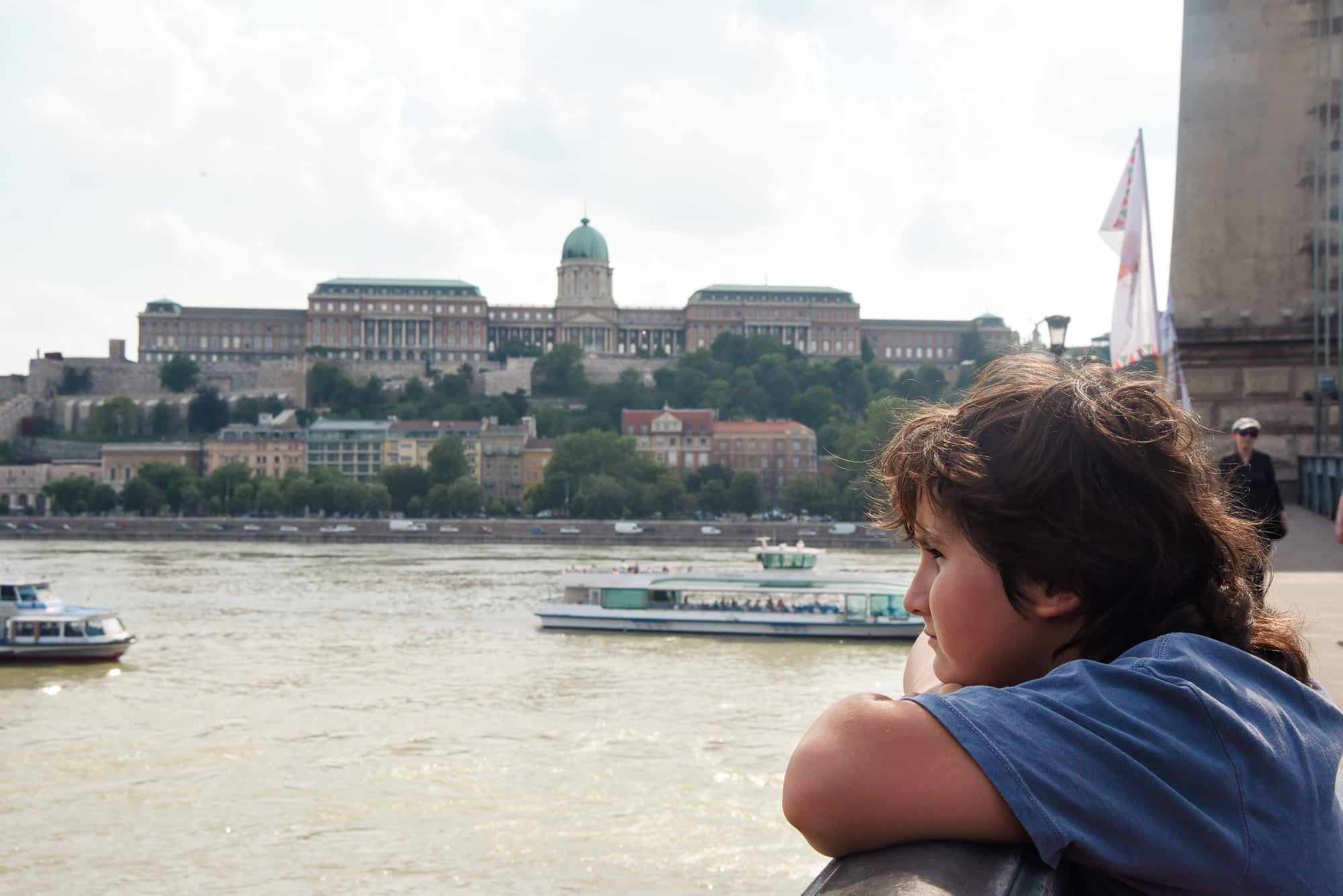 boy looking at the city of budapest