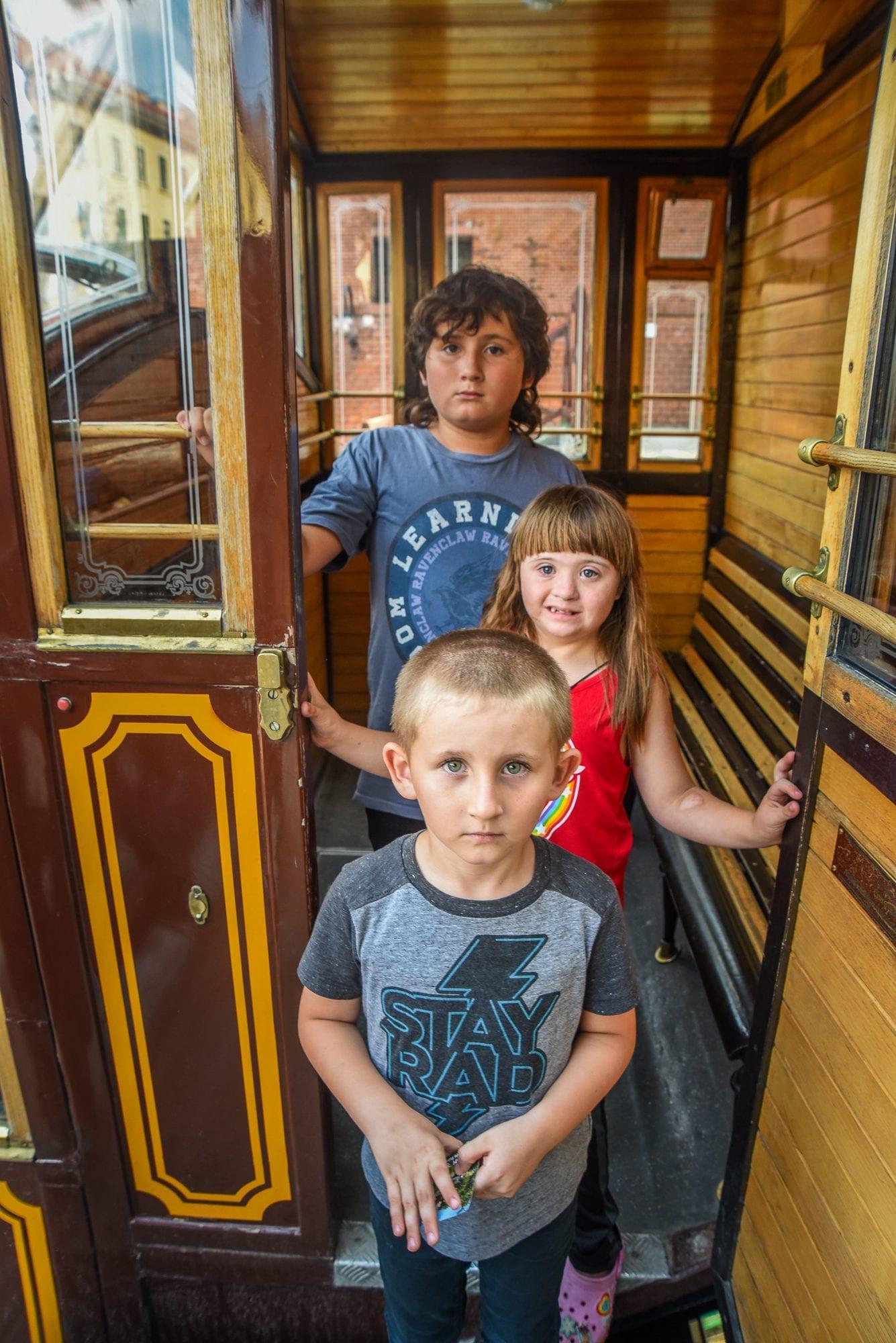 kids in funicular tram in budapest