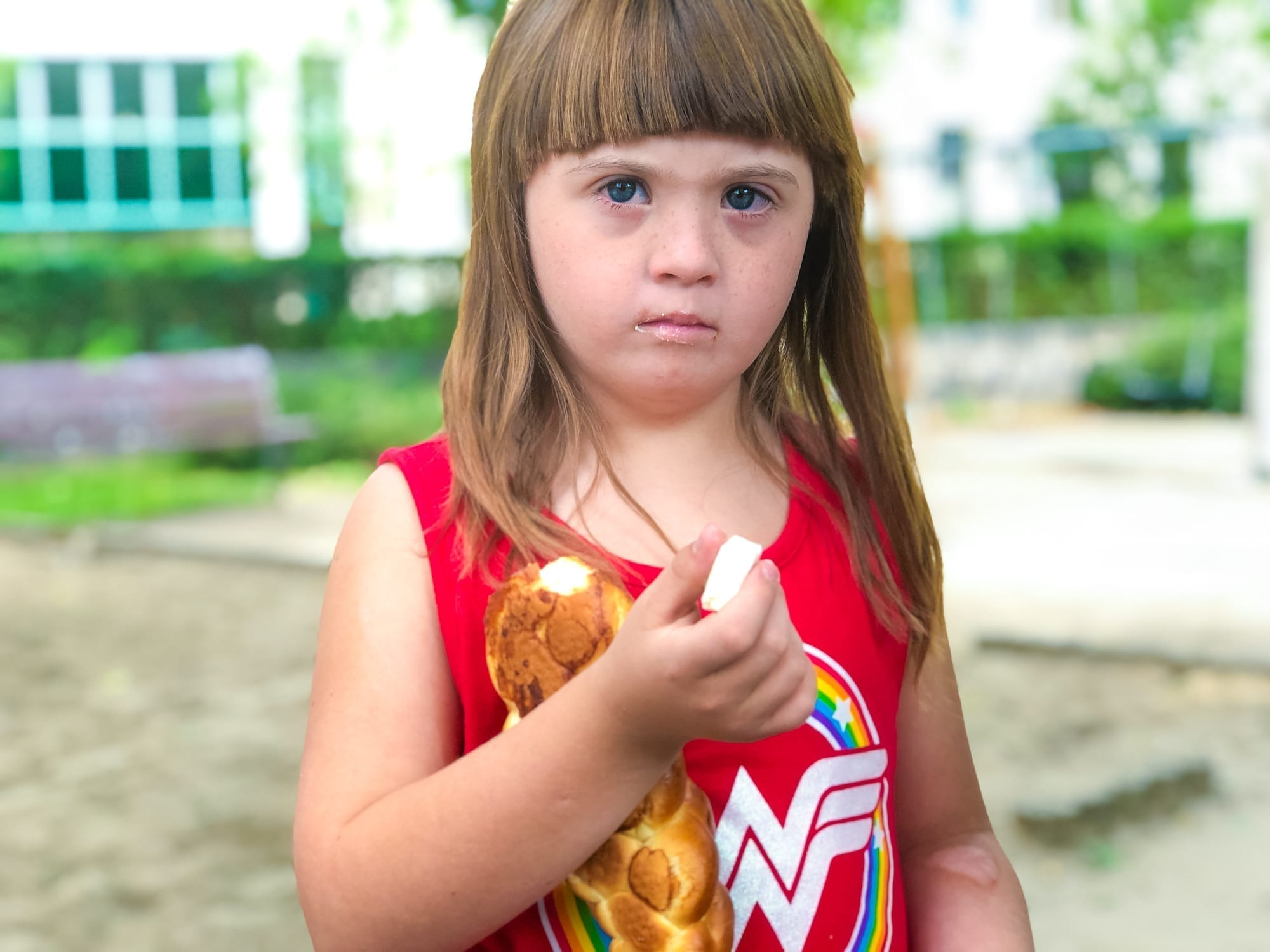 little girl holding bread and cheese