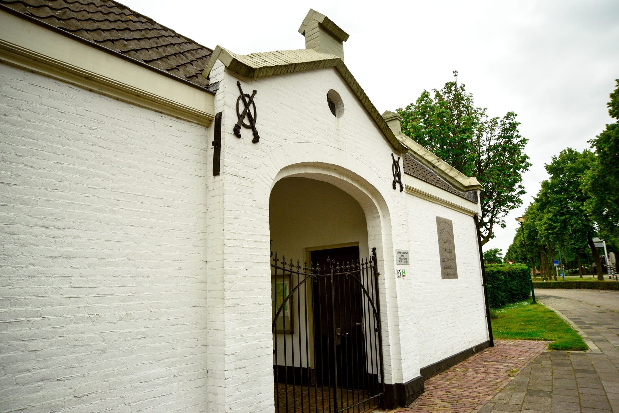 white building with a curved entry