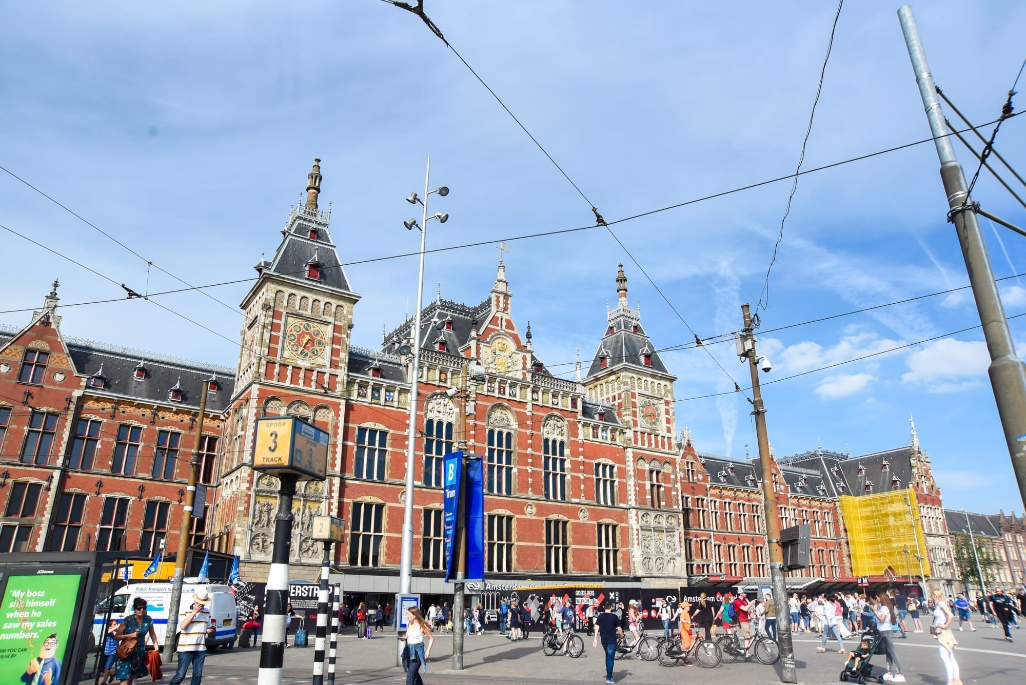 central station in Amsterdam with people milling around. the ground is flat