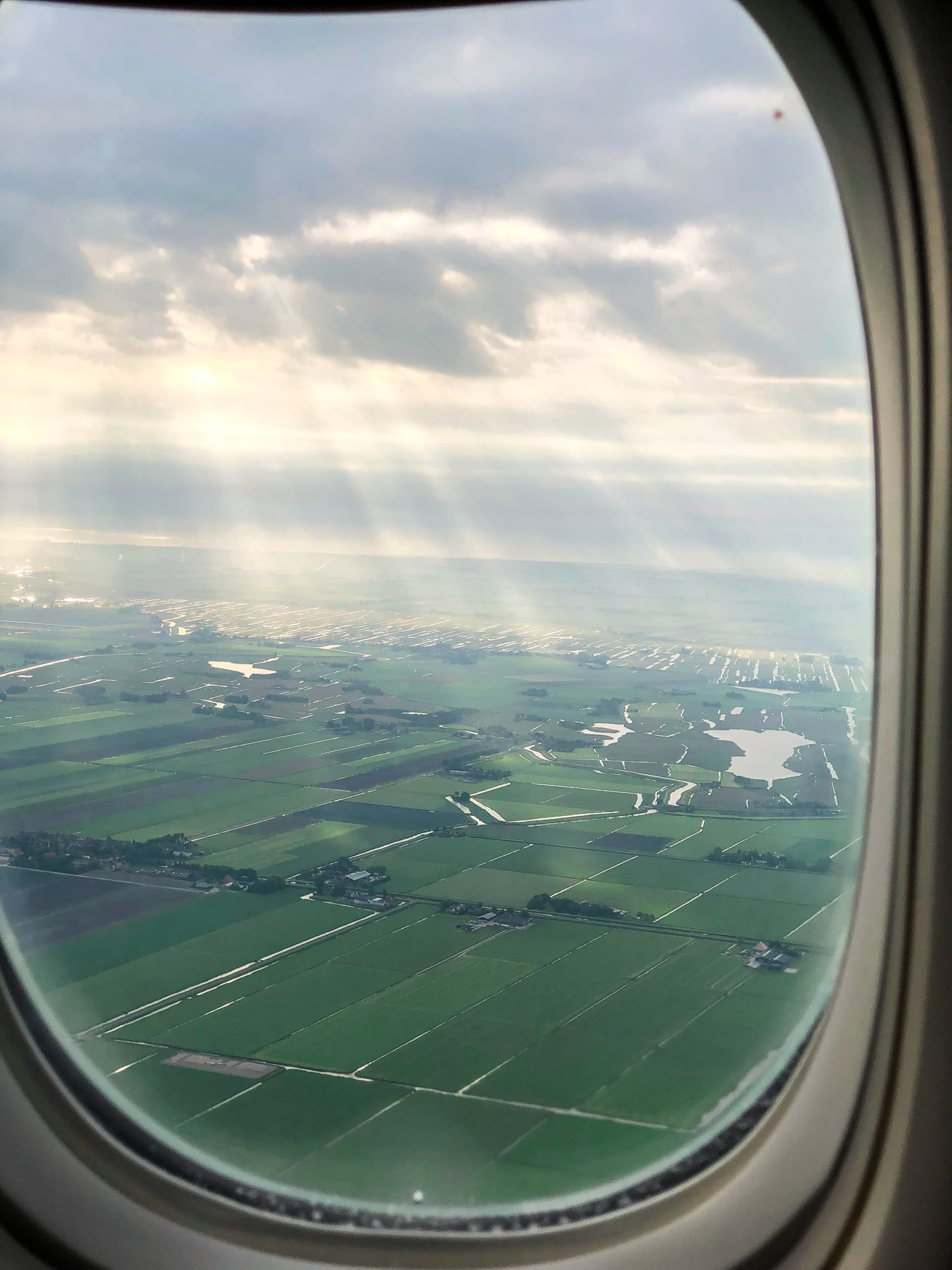 view from the plane of green, flat holland