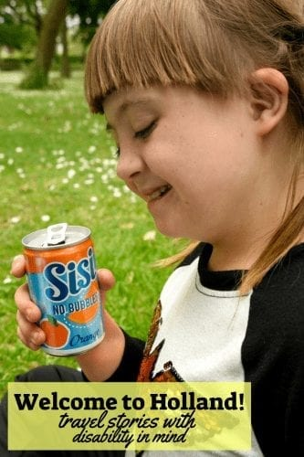 welcome to holland: travel stories with disability in mind, image of a girl with down syndrome smiling as she holds a can of juice