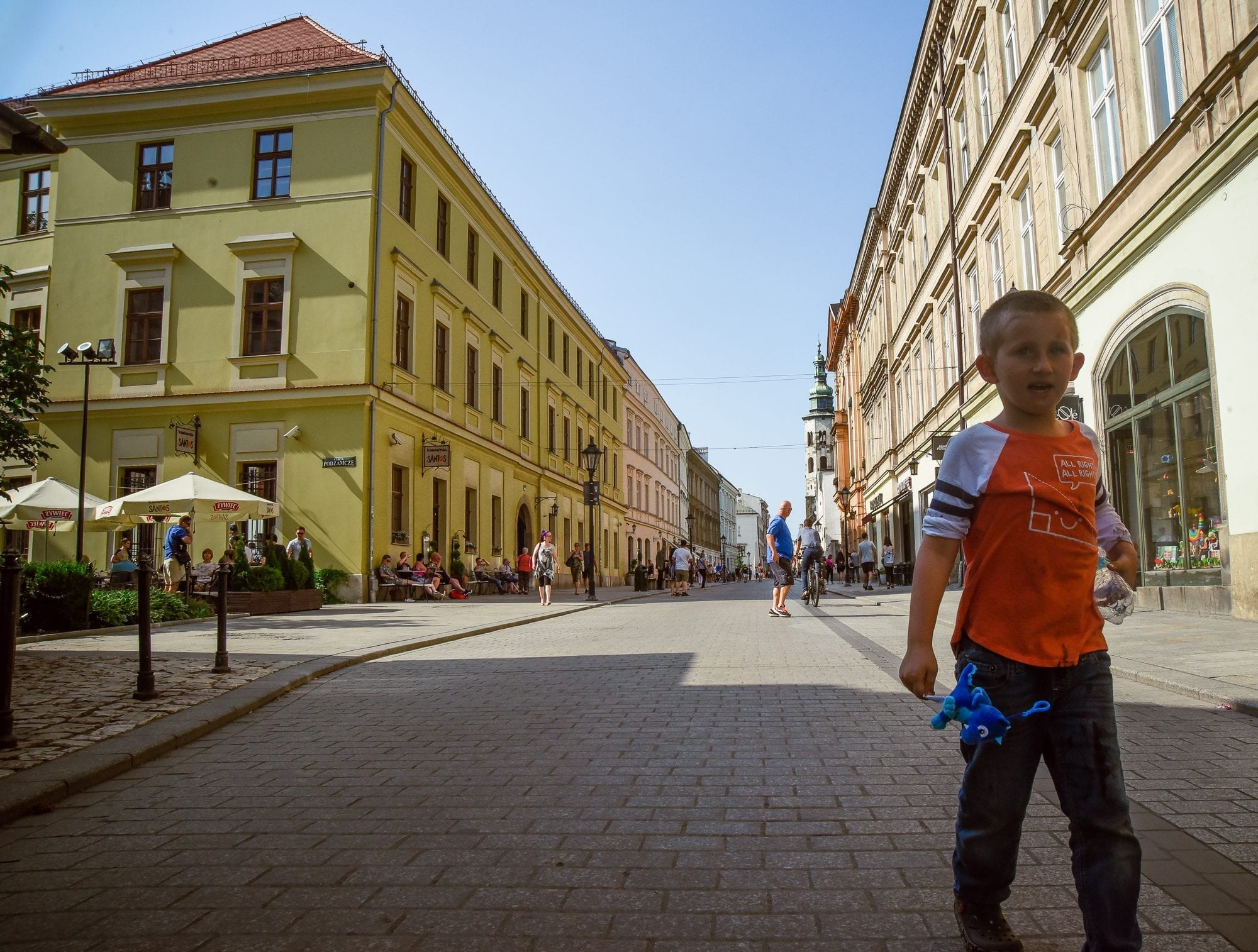 small boy in beautiful old market place street in krakow