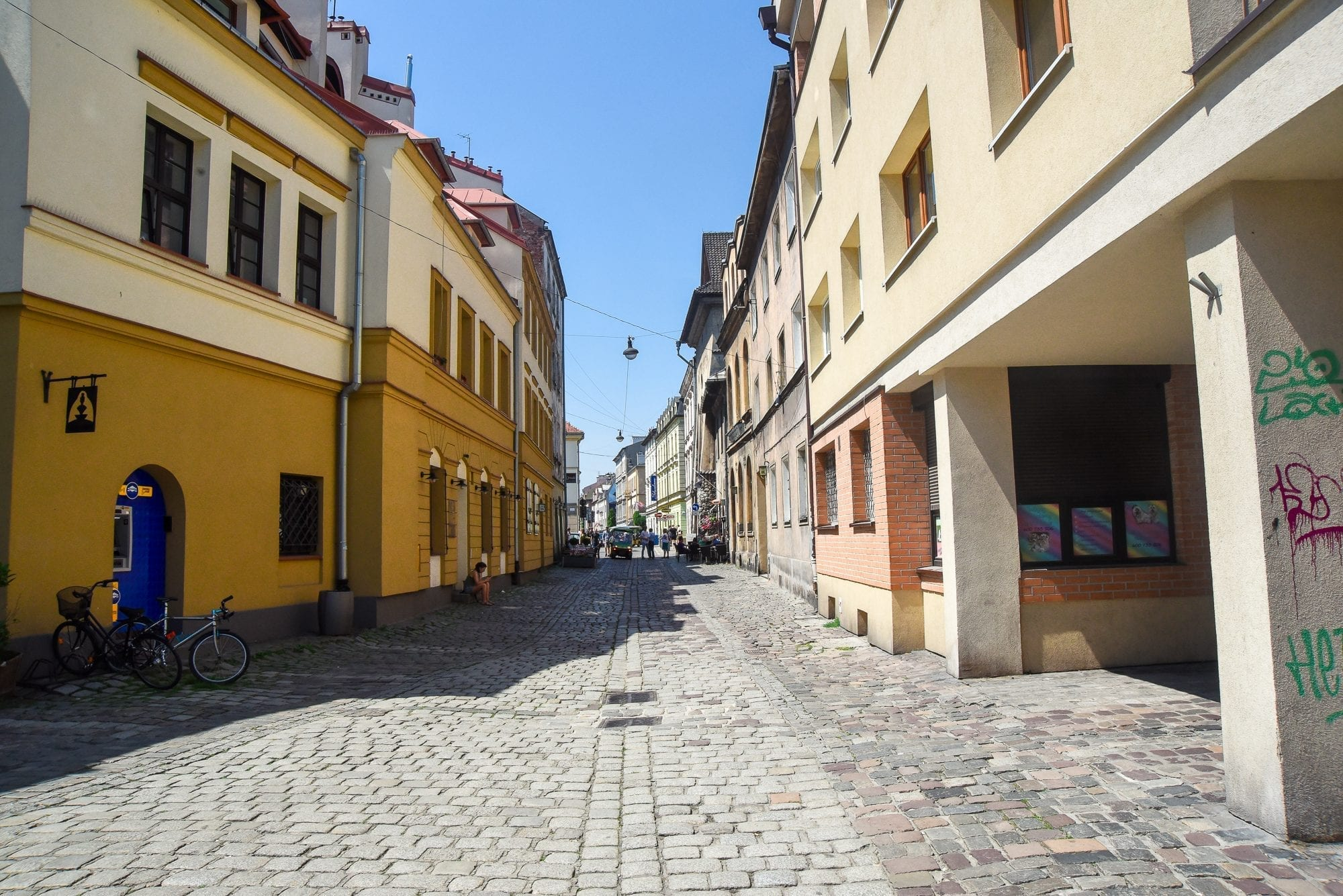 walking down the street in the jewish quarter of krakow