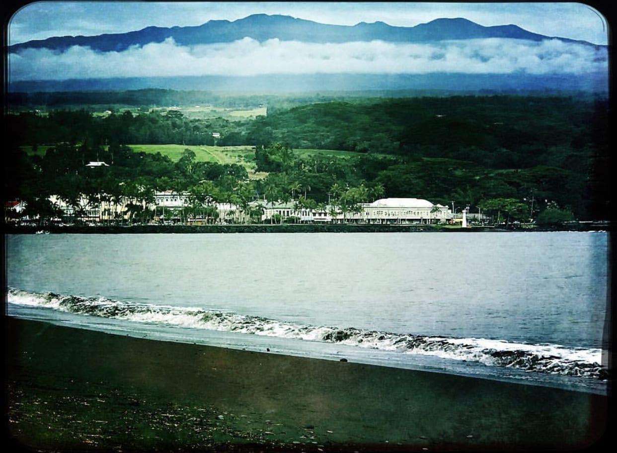 Mauna Kea soaring behind the town of Hilo, Hawaii