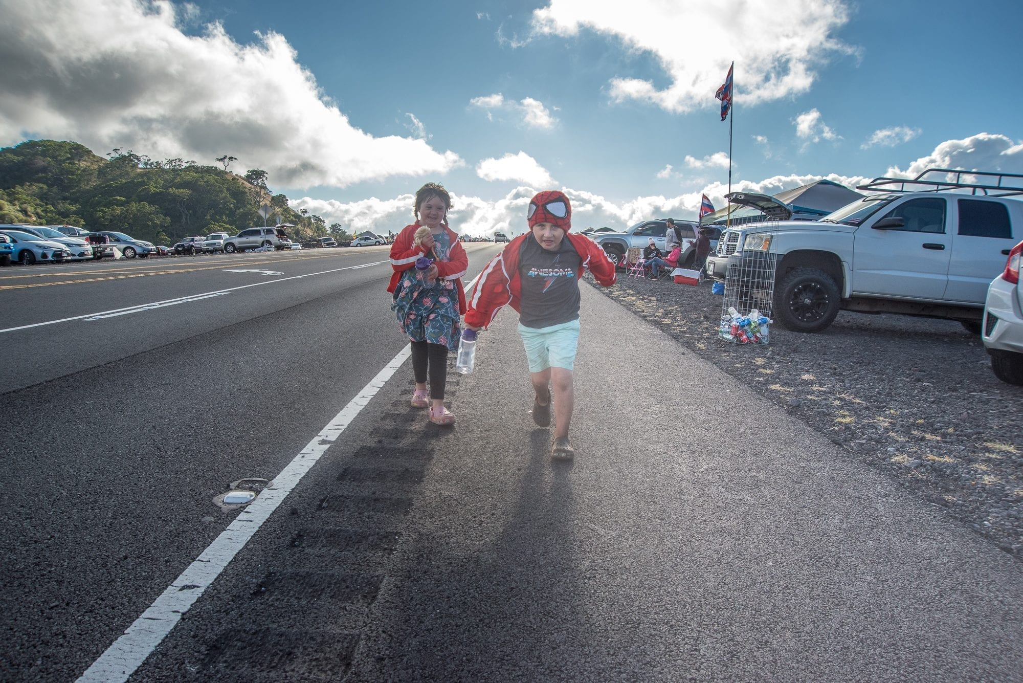 on being a Hawaiian ally, image of two children running by the Mauna Kea access road