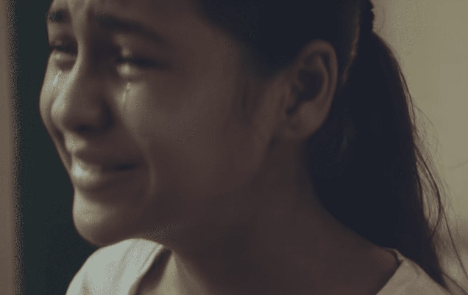 image of a girl crying with happiness