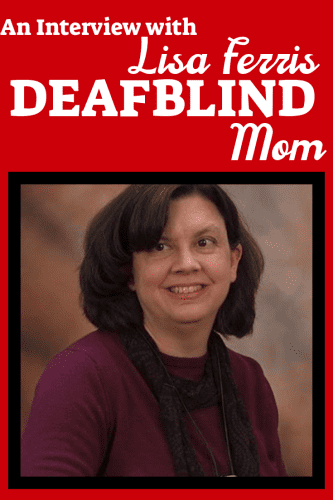 woman with dark hair and maroon shirt is smiling, around her neck is a silver box. her skin is light, her hair is dark brown and her eyes appear to be brown. interview with lisa ferris, deafblind mom for disabled moms interview project