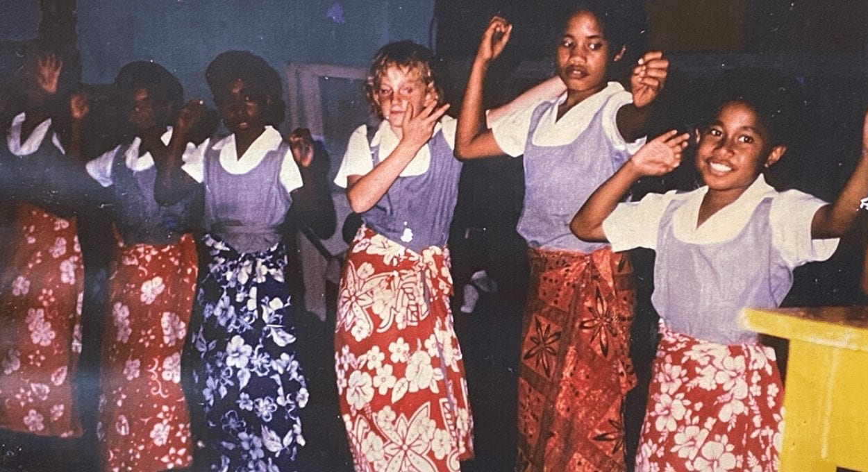 culture, disability and a game called Barnga. Image of girls dancing, with sulus wrapped around their school uniforms. one girl is white, all of the rest of the girls have darker skin