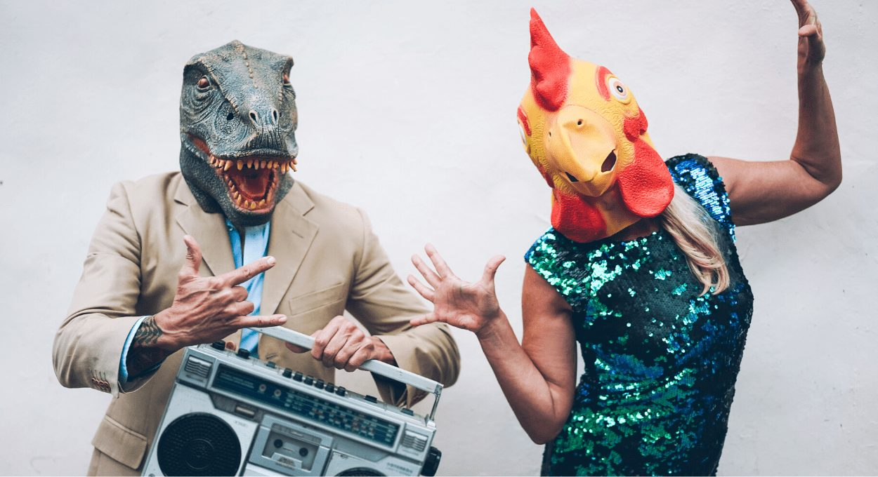 lipreader are screwed, how to communicate like the deaf! image of two people wearing masks, one of a dinosaur, and one with a chicken, carrying a boombox; one signing
