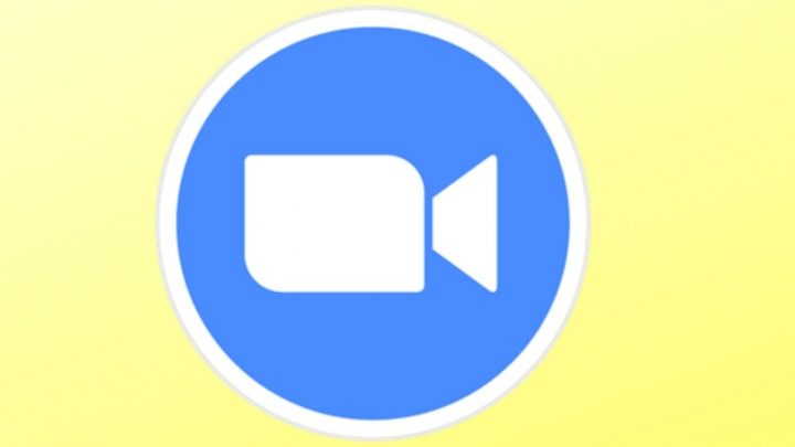 Free Zoom Captions: yellow back ground with a blue circle and inside the circle, an image of a video recorder - the logo of the company, Zoom