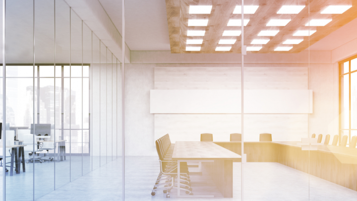tips for universal access at conferences: image of a conference room with light streaming in. there are many chairs surrounding very long tables and big windows