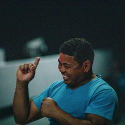 deaf awareness month - image of a man in blue V-neck t-shirt