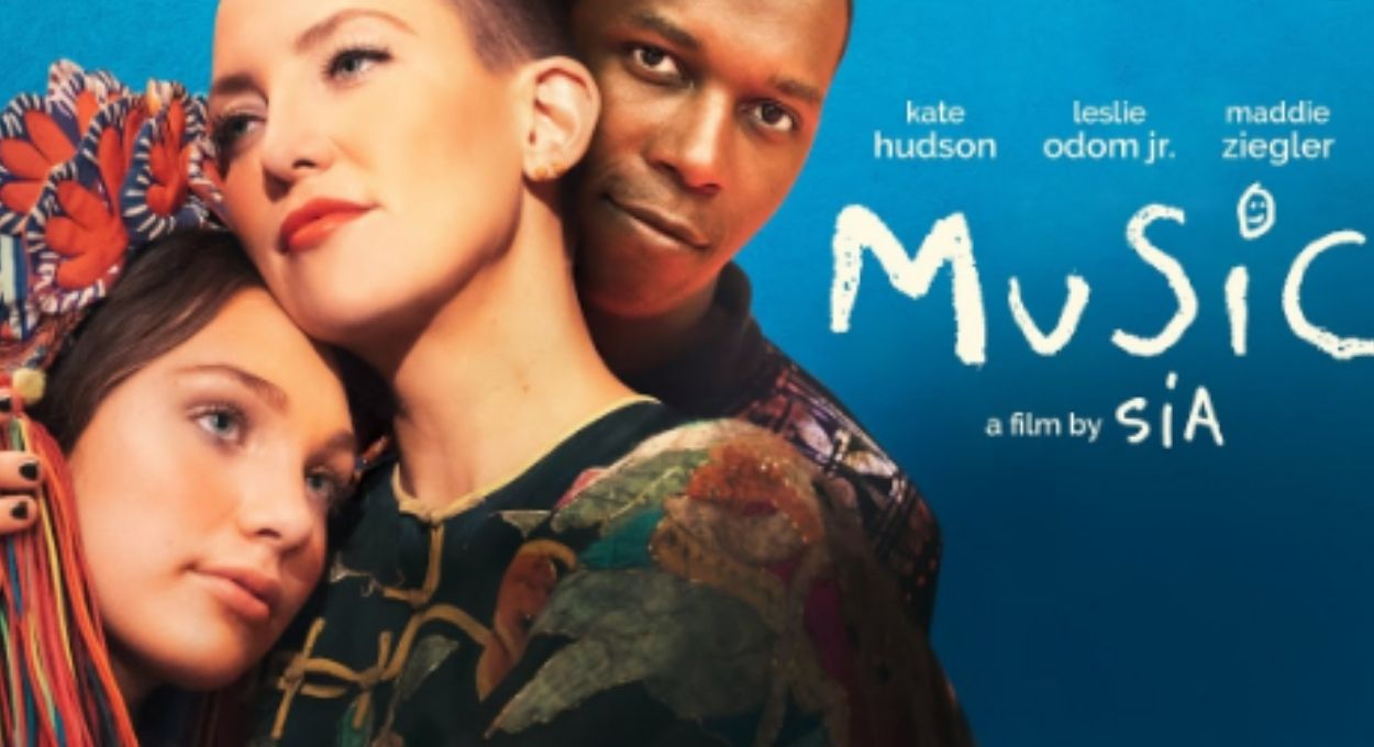 blue background, text reading Music, movie by Sia, starring Kate Hudson, Leslie Godom Jr, Maddie Ziegler, image of two white women nestled close and a black man behind the taller white woman