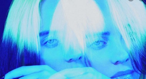 image of a woman, image is blue tinged and doubled.