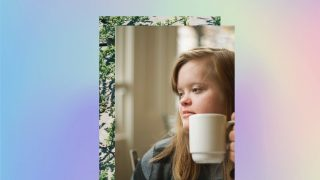 soft blurry rainbow background, square of green leaves and a young white woman with blonde hair holding a mug and looking off to the side - she has features associated with Down syndrome