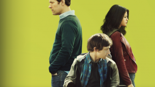 green text with a white man standing and looking to the side, a Latina woman in profile to the other side, and a young white man in a wheelchair sitting and looking to the same side as the woman standing - from The Fundamentals of Caring