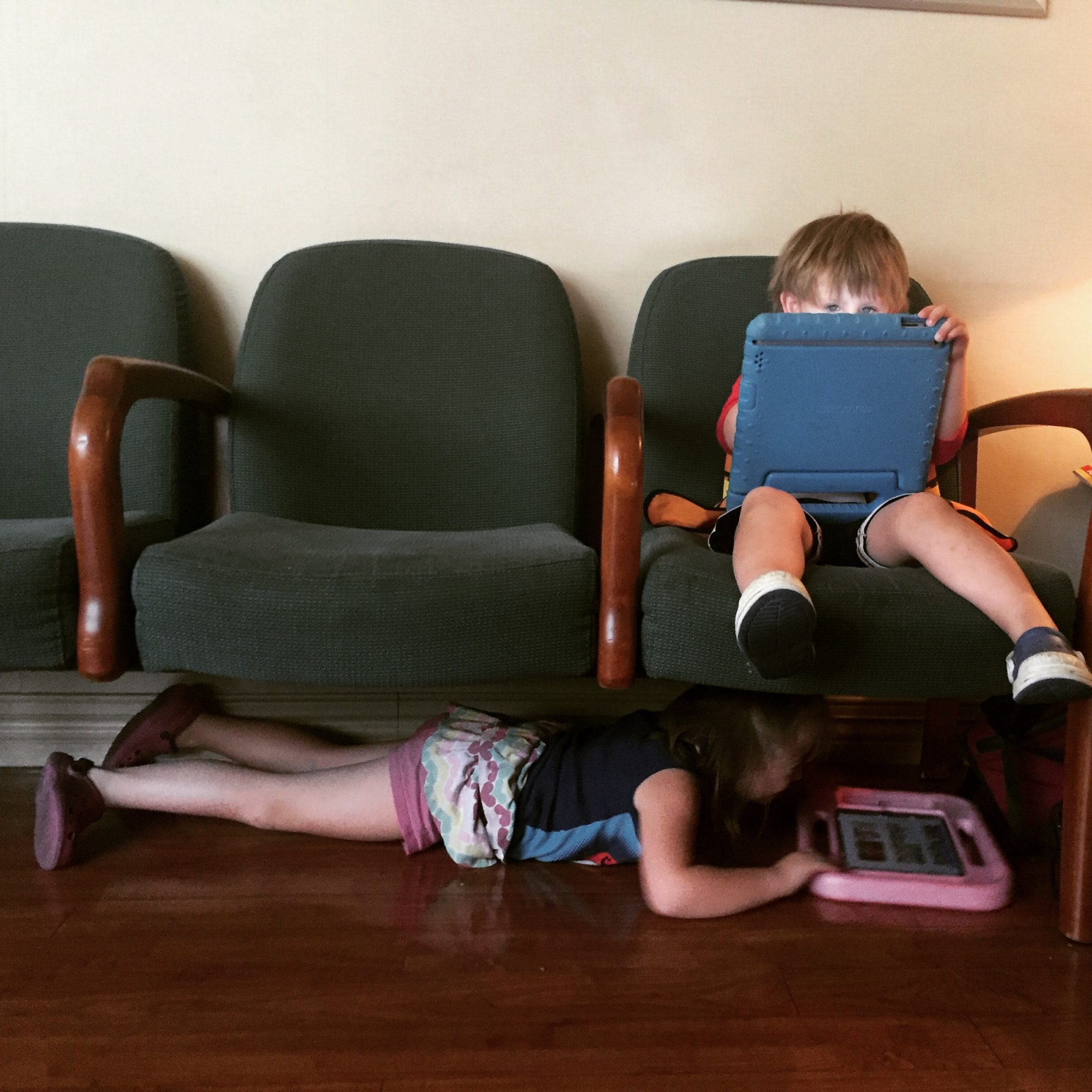 mack and moxie with their iPads in the waiting room