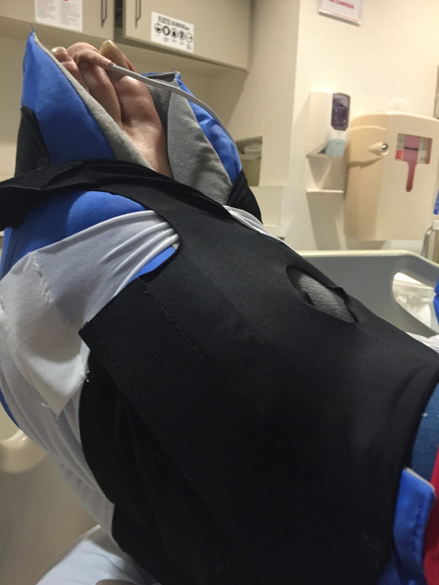 image of Dana's foot in the binding of the mechanized compressor