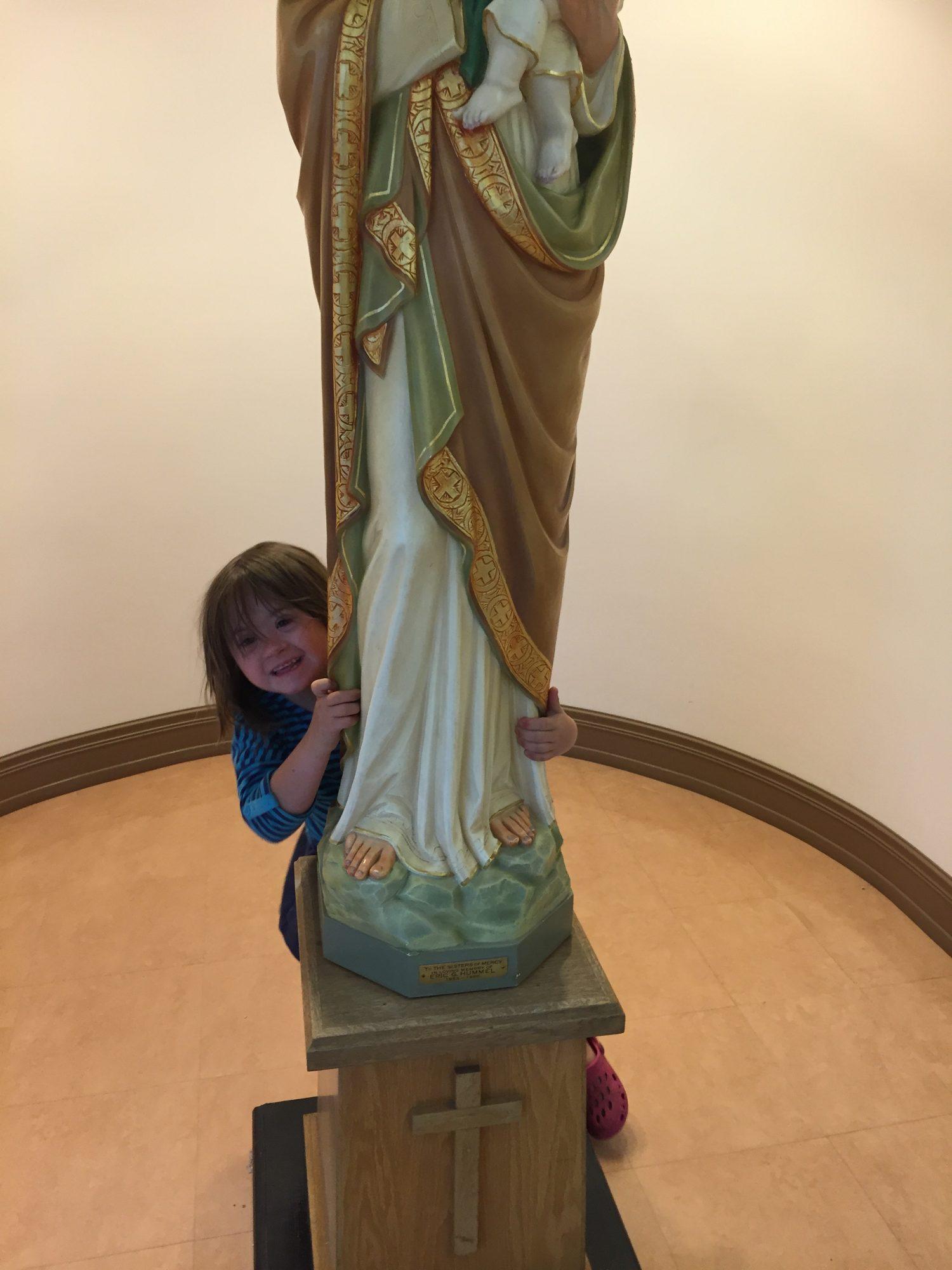 moxie hiding behind statue