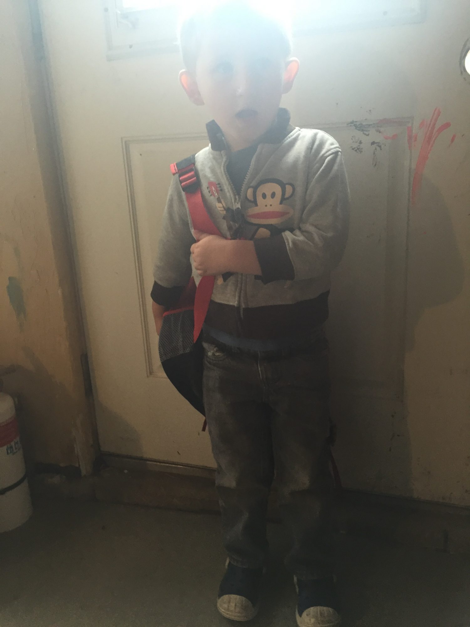 child in front of door
