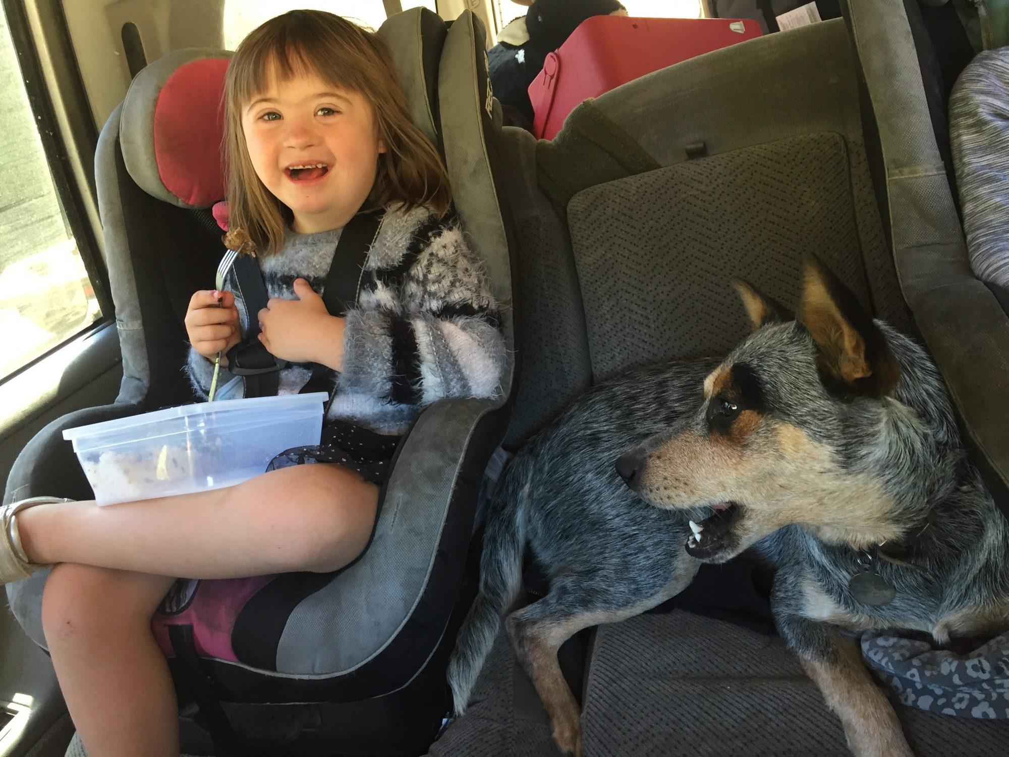 girl smiles in truck
