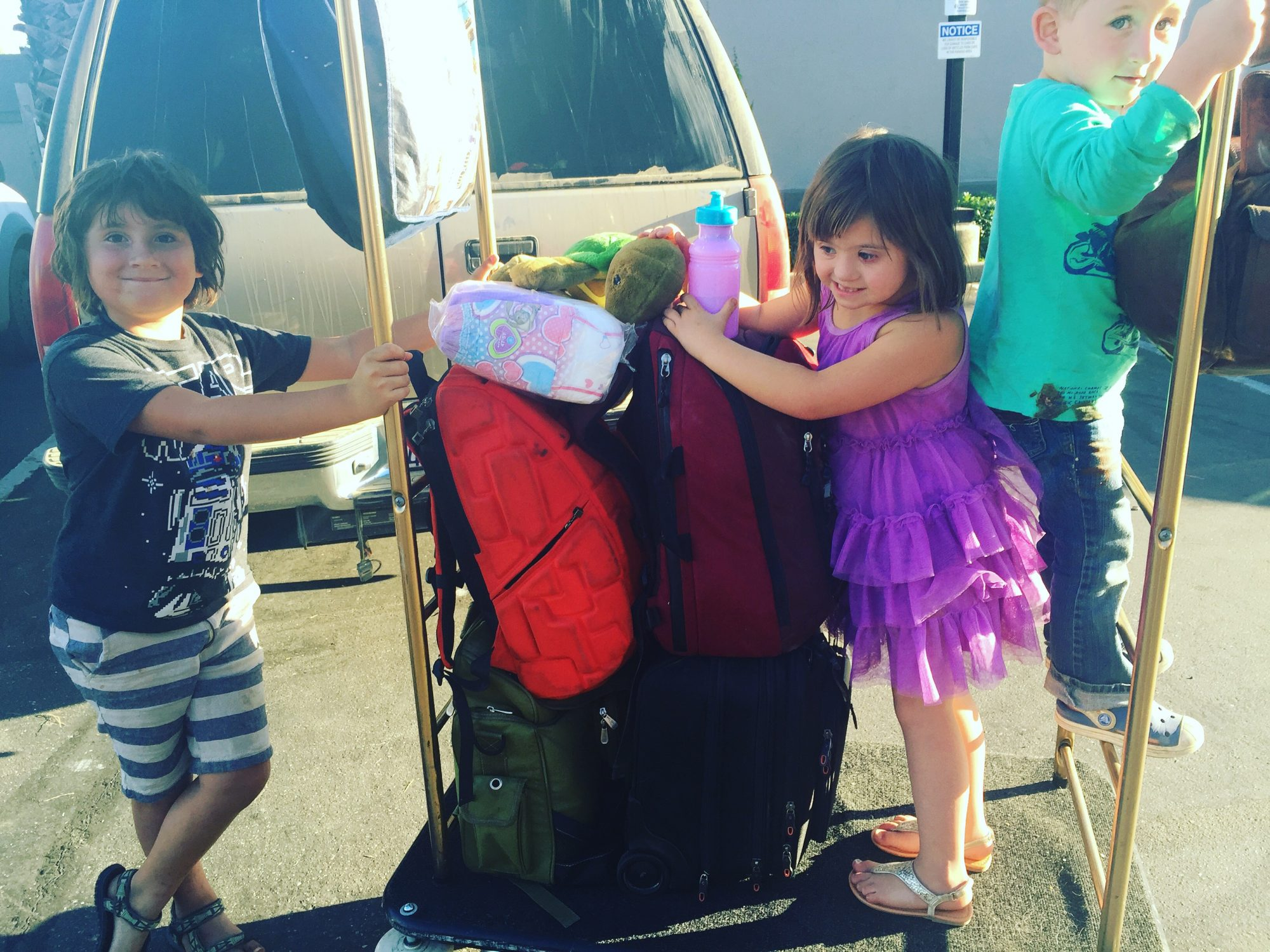 kids on luggage carrier
