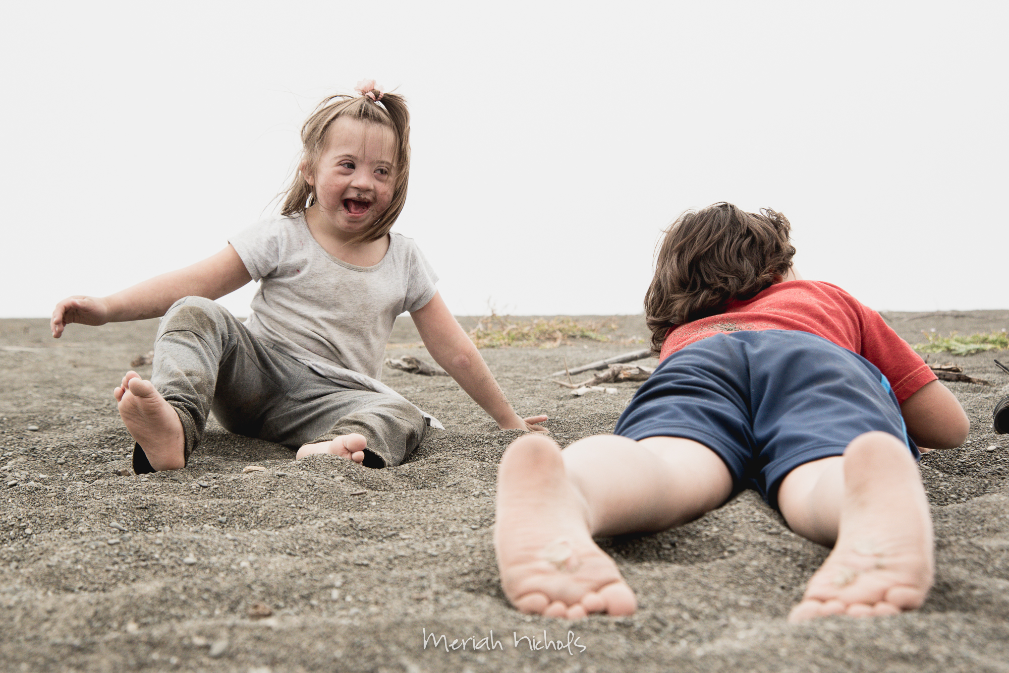 moxie laughing and playing in sand